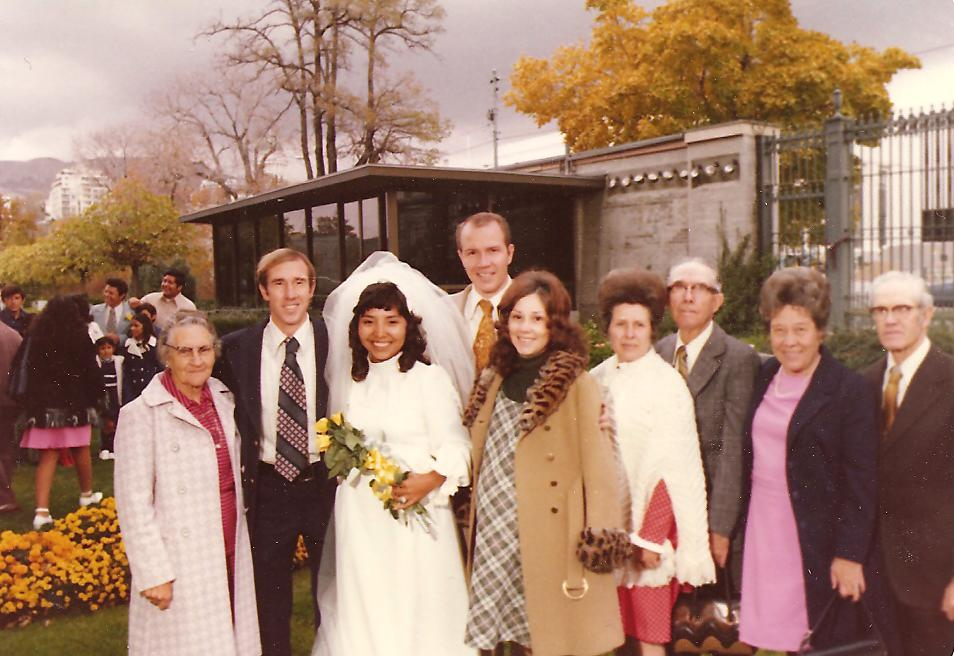 Pauline's wedding day with her foster parents and her husband's parents