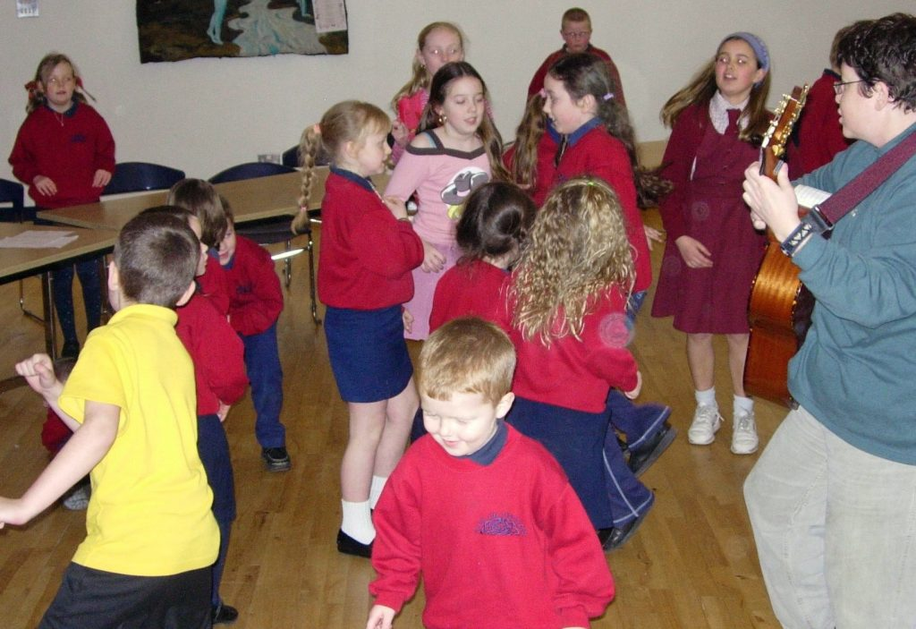 Liz teaching Catholic and Protestant children together in singing class, Northern Ireland 2005.