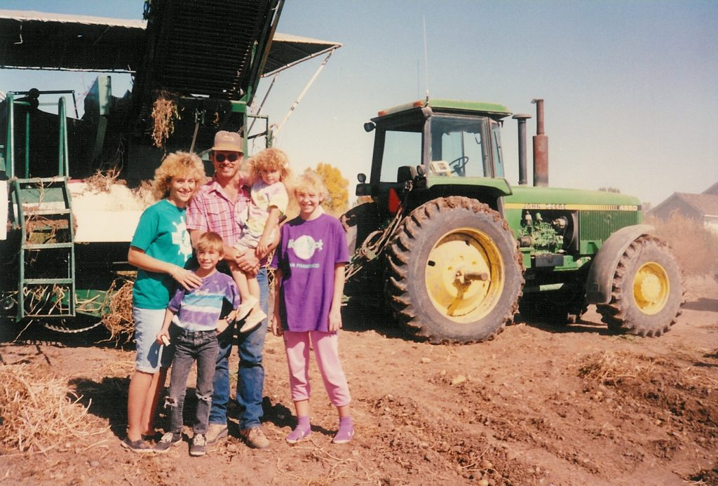 The Esplin family on their potato farm during spud harvest when Rachel was 3 years old